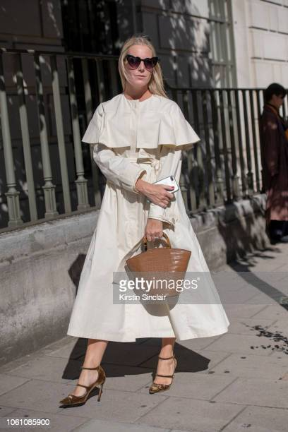 Vogue Contributor Alice NaylorLeyland wears a Delpozo coat Loeffler Randall bag Yves Saint Laurent sunglasses and Jimmy Choo shoes during London...