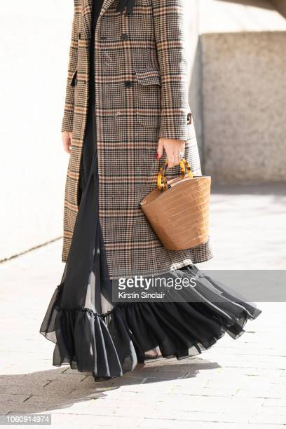 Vogue Contributor Alice NaylorLeyland wears a Hui Shan Zhang jacket and dress Loeffler Randall bag and Tods shoes during London Fashion Week...