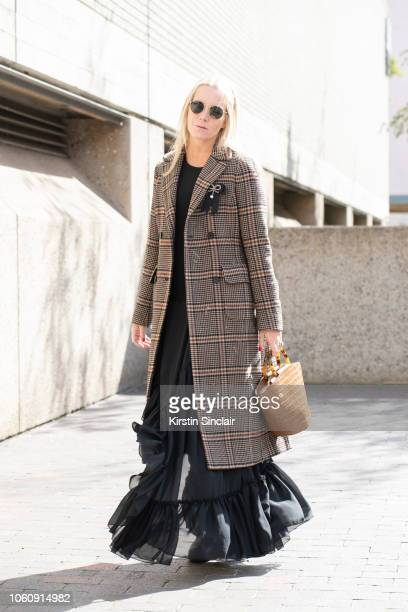 Vogue Contributor Alice NaylorLeyland wears a Hui Shan Zhang jacket and dress Loeffler Randall bag Ray Ban sunglasses and Tods shoes during London...