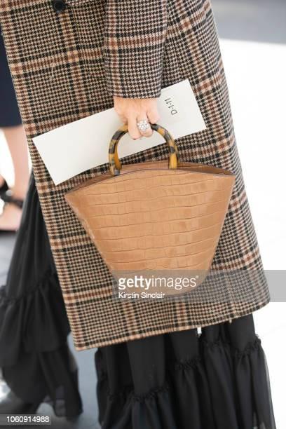 Vogue Contributor Alice NaylorLeyland wears a Hui Shan Zhang jacket and dress Loeffler Randall bag during London Fashion Week September 2018 on...