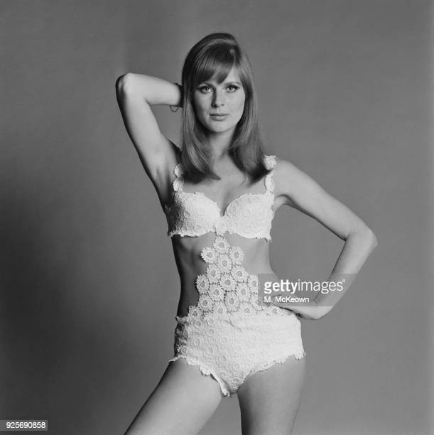 Vogue cover girl Paulene Stone wearing a white lace swimsuit by fashion designer Robert Roma UK 30th May 1968