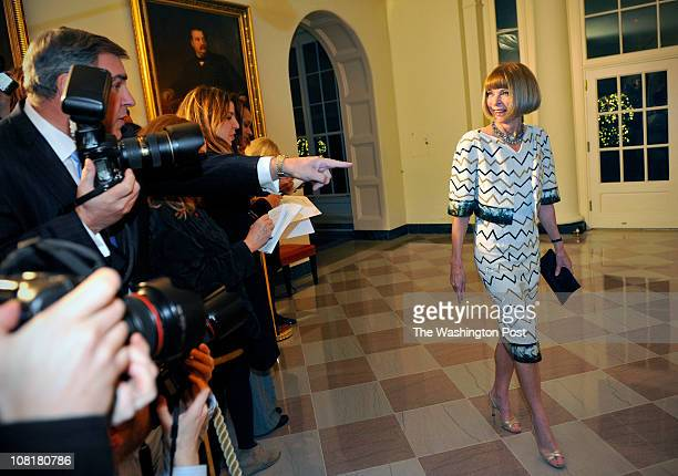 Vogue editor Anna Wintour passes by the press corps as she arrives before President Obama hosts Chinese President Hu Jintao at a State Dinner at the...