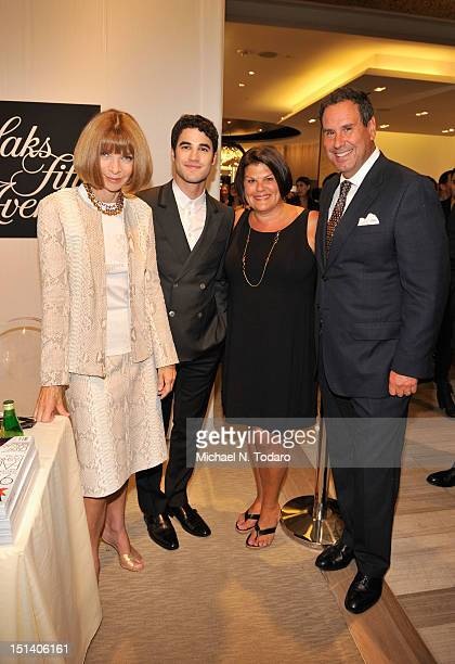 Vogue EditorinChief Anna Wintour actor Darren Criss Karin Sadove and Chairman and CEO of Saks Fifth Avenue Stephen Sadove attend Fashion's Night Out...