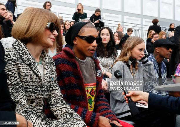 US Vogue editorinchief Anna Wintour US singer Pharrell Williams and USFrench model and actress LilyRose Depp attend the Chanel women's FallWinter...