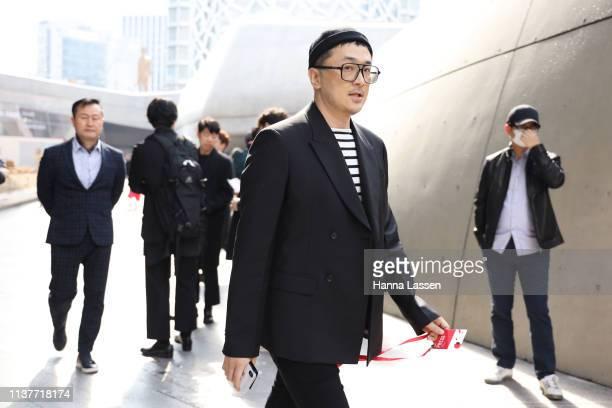 Vogue Korea editorinchief Shin Kwangho wearing black beanie black blazer and black and white striped shirt is seen at the Hera Seoul Fashion Week...