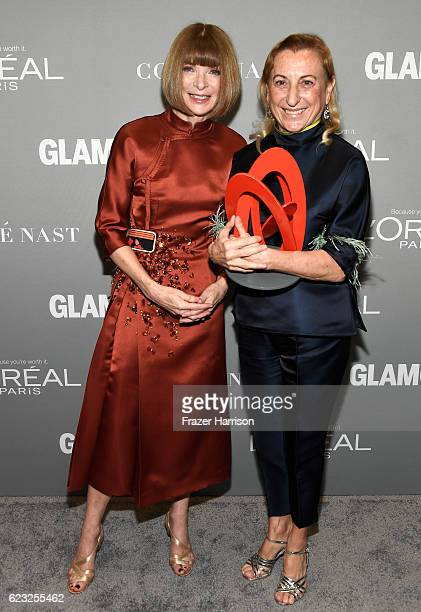 Vogue magazine EditorinChief Anna Wintour and honoree Muccia Prada pose with an award at Glamour Women Of The Year 2016 at NeueHouse Hollywood on...