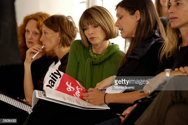 Vogue Magazine EditorinChief Anna Wintour reads The Daily at the Behnaz Sarafpour Spring/Summer 2004 fashion show at Peter White Gallery during the...
