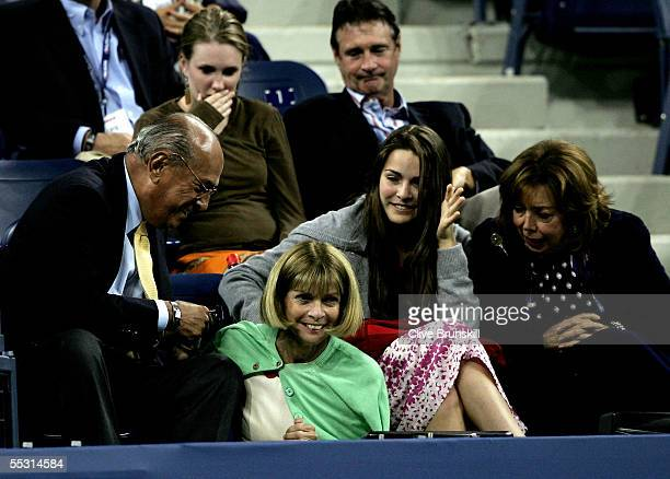 Vogue magazine editorinchief Anna Wintour slips as she returns to her seat during the quarterfinal matches on Day 10 of the US Open at the USTA...