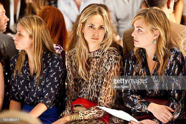 Vogue Style Editor at Large Elisabeth von Thurn und Taxis watches a model on the runway at the Suno spring 2013 fashion show during Mercedes-Benz...