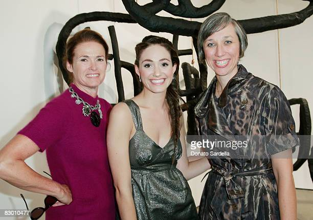 Vogue westcoast editor Lisa Love and actress Emmy Rossum pose with artist Alexandra Grant at at dinner hosted by Vogue and Mulberry celebrating the...
