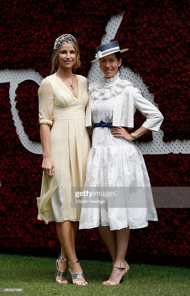 Vogue Williams (L) and Lisa Tan attend day four of the Qatar Goodwood Festival at Goodwood Racecourse on July 31, 2015 in Chichester, England.