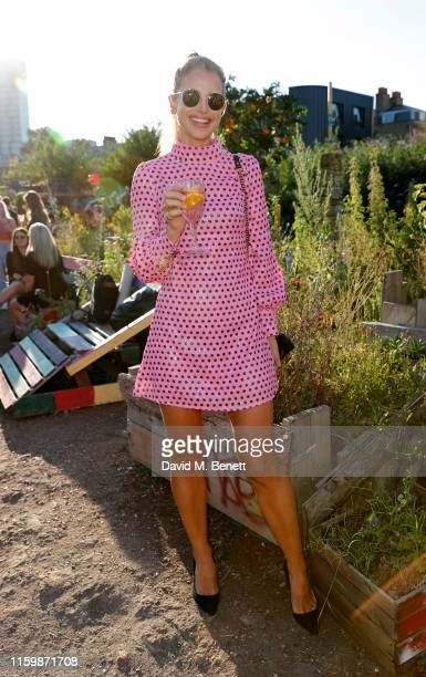 Vogue Williams attends the Smirnoff Infusions Pick Your Own launch party at the Nomadic Community Gardens on July 03 2019 in London England