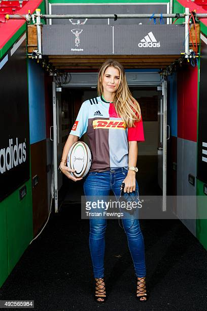 Vogue Williams poses for pictures wearing Harlequins kit during a Harlequins photo call at Twickenham Stoop on October 13 2015 in London England...