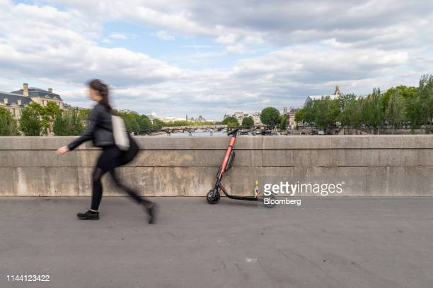A Voi Technology AB public hire escooter rests on a bridge over the River Seine in Paris France on Thursday May 16 2019 Uber Technologies Inc is...