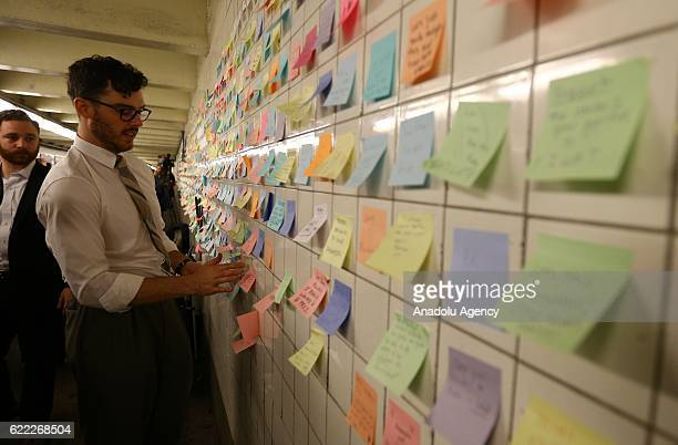 Voice Actor Matthew Chavez poses near his public art project named Subway Therapy People as people write their messages on selfstick paper at the 6th...