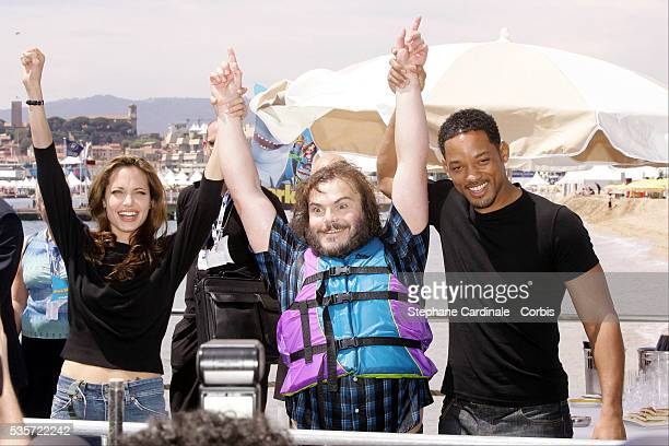 Voice actors Angelina Jolie Jack Black and Will Smith attend a photocall for Bibo Bergeron and Vicky Jenson's animation movie 'Shark Tale' at the...