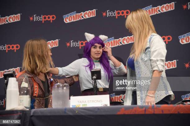 Voice actors Greg Cipes and Tara Strong greet a fan onstage at the Let's Be Heroes panel during New York Comic Con 2017 JK at Jacob K Javits...