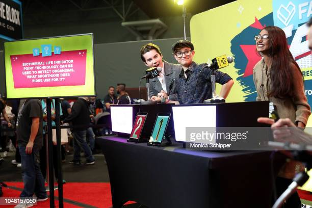 Voice actors Jeremy Shada and Bex TaylorKlaus of Voltron compete against a guest in Fandom Fued while visiting FANDOM At New York ComicCon on October...