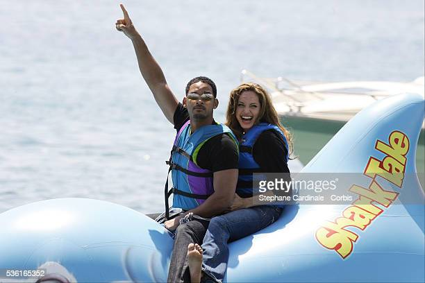 Voice actors Will Smith and Angelina Jolie attend a photocall for Bibo Bergeron and Vicky Jenson's animation movie 'Shark Tale' at the 57th Cannes...
