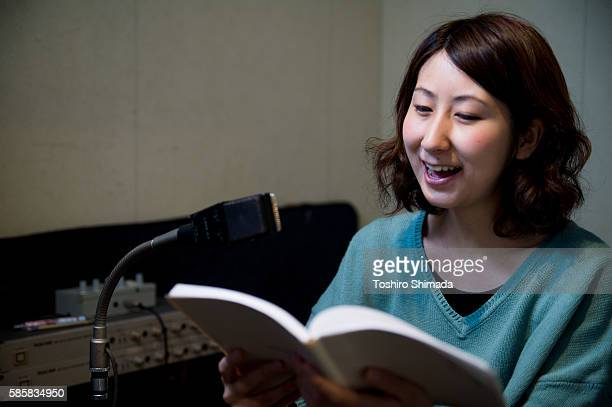 a voice actrees  recording her voice at recording studio - voice acting stock pictures, royalty-free photos & images