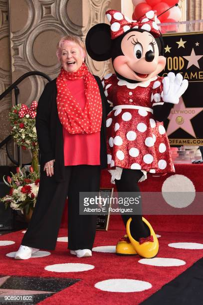 Voice actress Russi Taylor who has voiced Minnie Mouse since 1986 poses with Minnie Mouse during a star ceremony in celebration of the 90th...