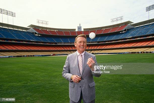 Voice of the Los Angeles Dodgers radio broadcasts, Vin Scully, poses in the outfield of Dodger Stadium, Los Angeles, California.