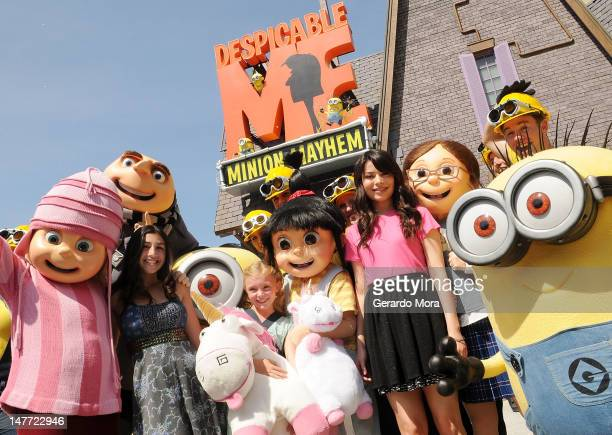 Voices characters of animated movie 'Despicable Me' Dana Gaier Elsie Fisher and Miranda Cosgrove pose during the Grand Opening of Despicable Me...