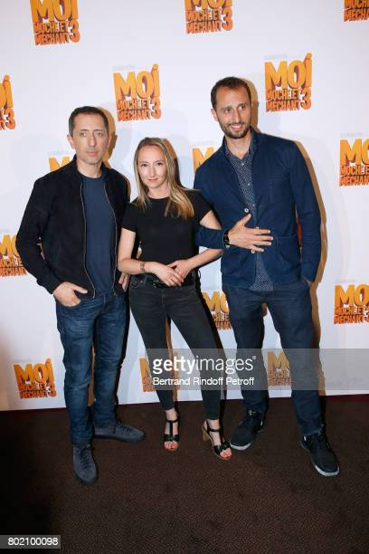 Voices of the movie Audrey Lamy standing between Gad Elmaleh and his brother Arie Elmaleh attend the Despicable Me Paris Premiere at Cinema Gaumont...