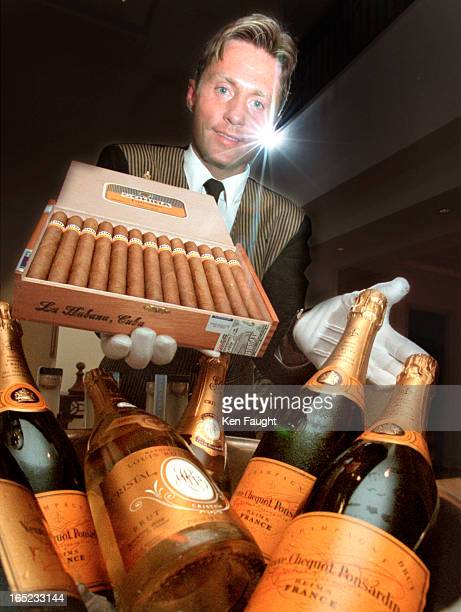 Voitek Litwnski, a banquet server with the Hyatt offers up a $1700 box of Cohiba 1. Esplendidos along with caviar, chocolate dipped strawberries, and...