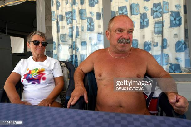 Vojko and Vesna Blaznik a couple from Slovenian capital Ljubljana sit as they tell their story at the Kanegra naturist campsite in northern Croatia's...
