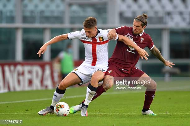 Vojnovic Lyanco of Torino FC competes with Andrea Pinamonti of Genoa CFC during the Serie A match between Torino FC and Genoa CFC at Stadio Olimpico...