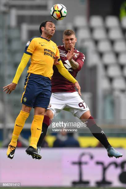 Vojnovic Lyanco of Torino FC goes up with Giampaolo Pazzini of Hellas Verona FC during the Serie A match between Torino FC and Hellas Verona FC at...