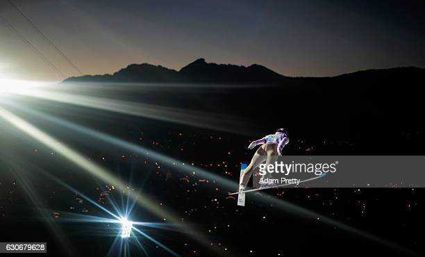 Vojtech Stursa of Czech Republic soars through the air during his first competition jump on Day 2 of the 65th Four Hills Tournament ski jumping event...