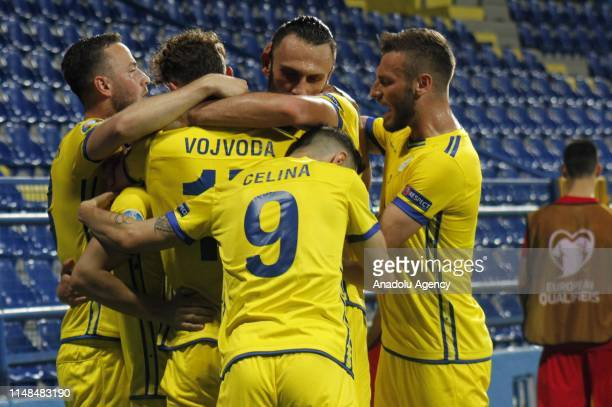 Vojvoda of Kosovo celebrates with his teammates after their goal during 2020 UEFA European Football Championship Group A soccer match between...
