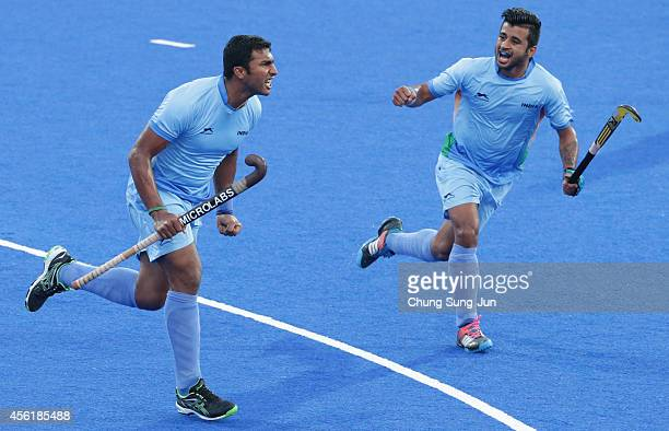 Vokkaliga Ramachandra Raghunath of India celebrates after scores a goal during the during the Hockey Men's Pool B match between India and China...