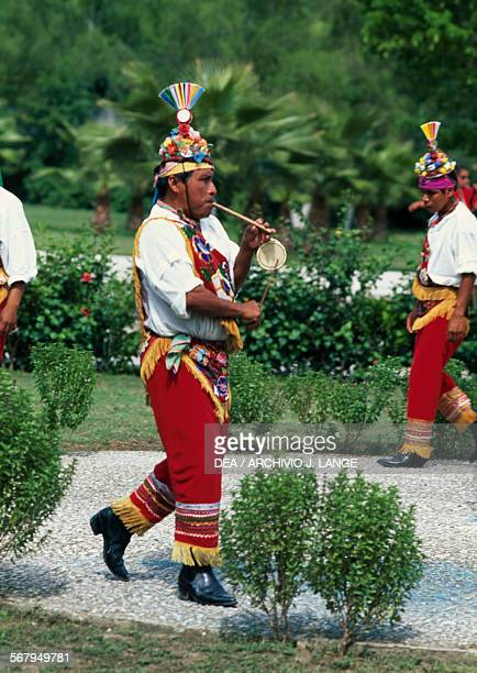 Voladores dancing and playing instruments before getting on the pole El Tajin Veracruz Mexico