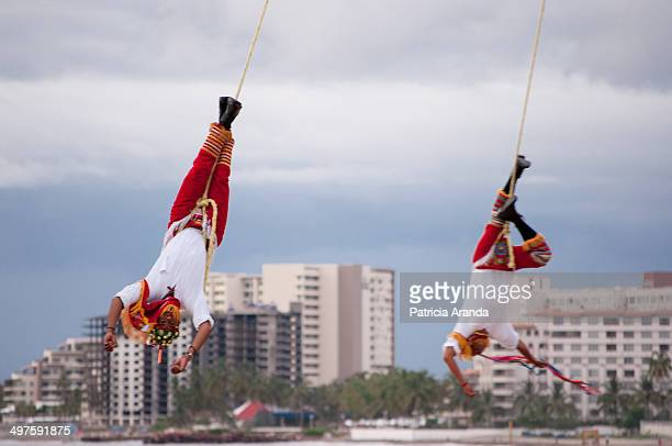 CONTENT] Voladores de Papantla a mexican spectacular dance about fertility In this tradition 5 people spin around a mast that has approx 30 mts...
