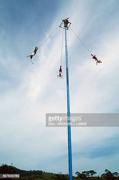 Voladores launching themselves from the platform atop the pole El Tajin Veracruz Mexico