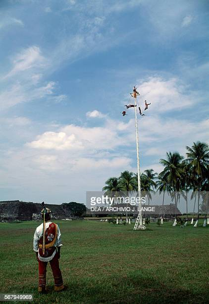 Voladores launching themselves from the platform atop the pole Cempoala Veracruz Mexico