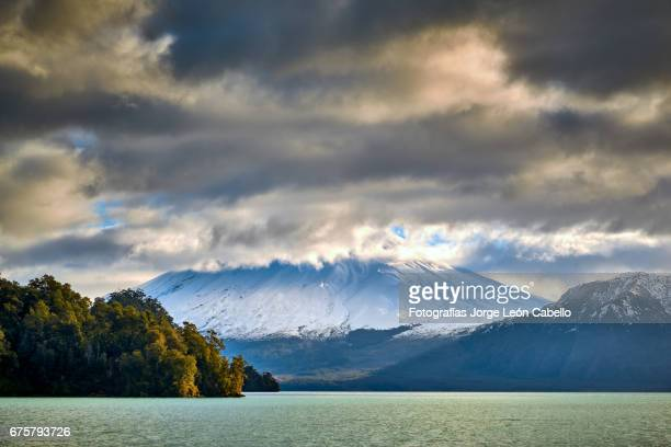 volcan osorno view from the catamaran during the winter andean lake crossing - azul turquesa stock pictures, royalty-free photos & images