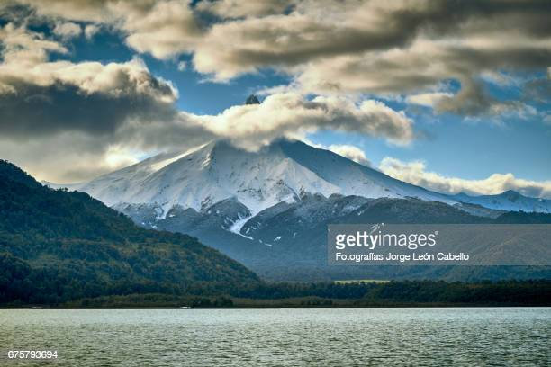 volcan puntiagudo view from the catamaran during the winter andean lake crossing - azul turquesa stock pictures, royalty-free photos & images