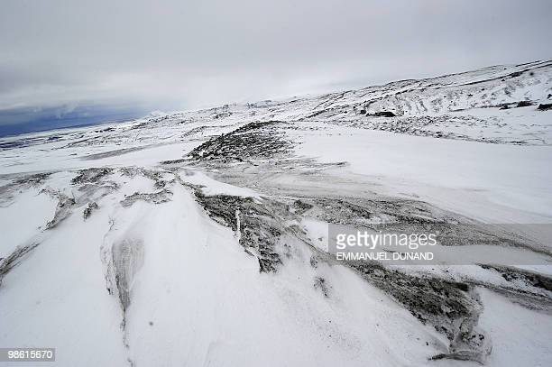 Volcanic ash leaves dark streaks on the Myrdalsjokull glacier which is part of the ice cap sealing the Katla volcano near the Icelandic village of...