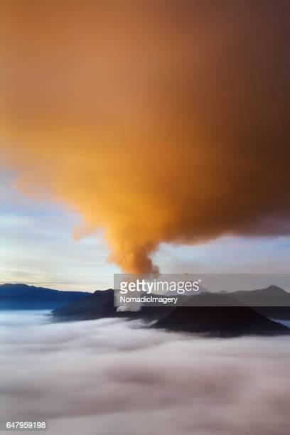 Volcanic ash painted orange during sunrise at Mount Bromo