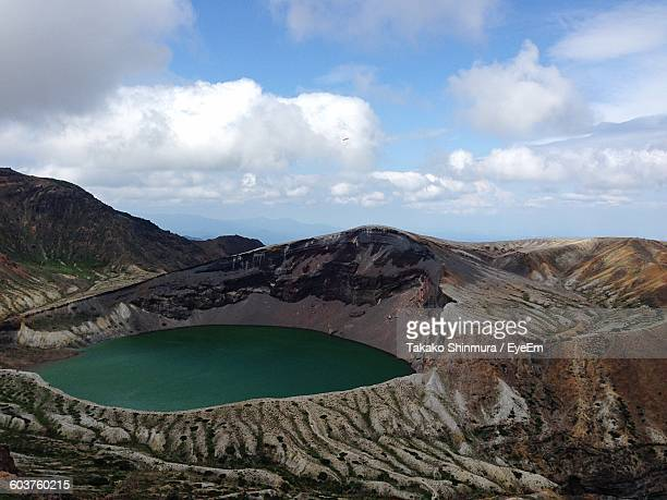 Volcanic Crater Against Cloudy Sky