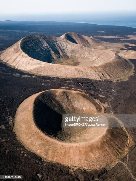 volcanic crater, timanfaya national park, drone shot, lanzarote, spain - cratere vulcano foto e immagini stock