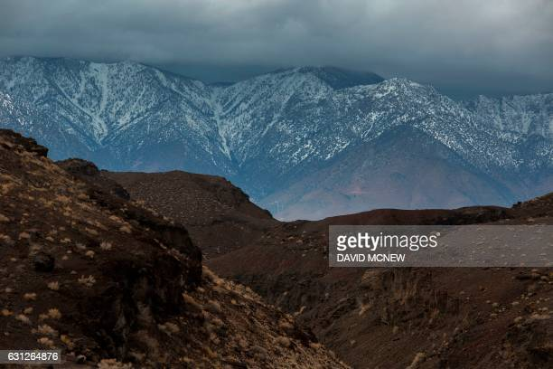 A volcanic desert landscape is seen with snowy Eastern Sierra Nevada Mountains in the distance near Lone Pine California January 8 2017 as a series...