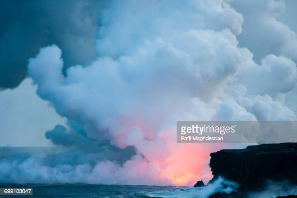 A Volcanic Eruption Over The Ocean With Lots Of Billowing Smoke