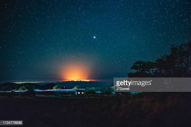 volcanic eruption under a starry sky - pele goddess stock pictures, royalty-free photos & images