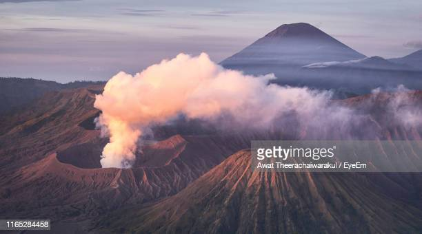 volcanic landscape against sky during sunset - east java province stock pictures, royalty-free photos & images