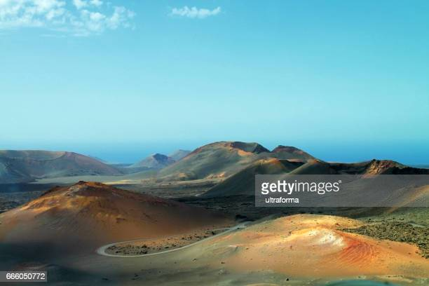 volcanic landscape in timanfaya lanzarote at sunset - timanfaya national park stock pictures, royalty-free photos & images